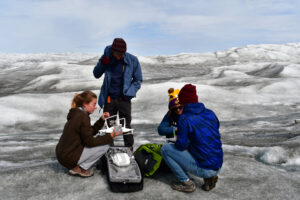 Abby Meyer and colleagues packing up a drone. Image credit: Personal Archive