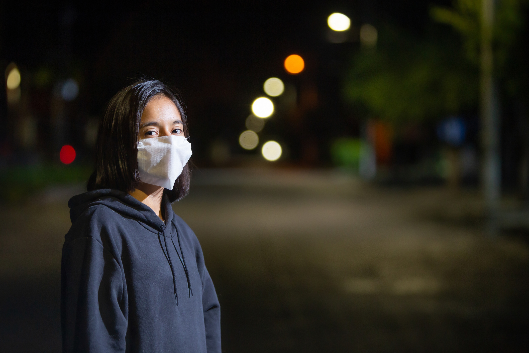 Teenage woman wearing a face mask during the COVID-19 pandemic. Image credit: iStock