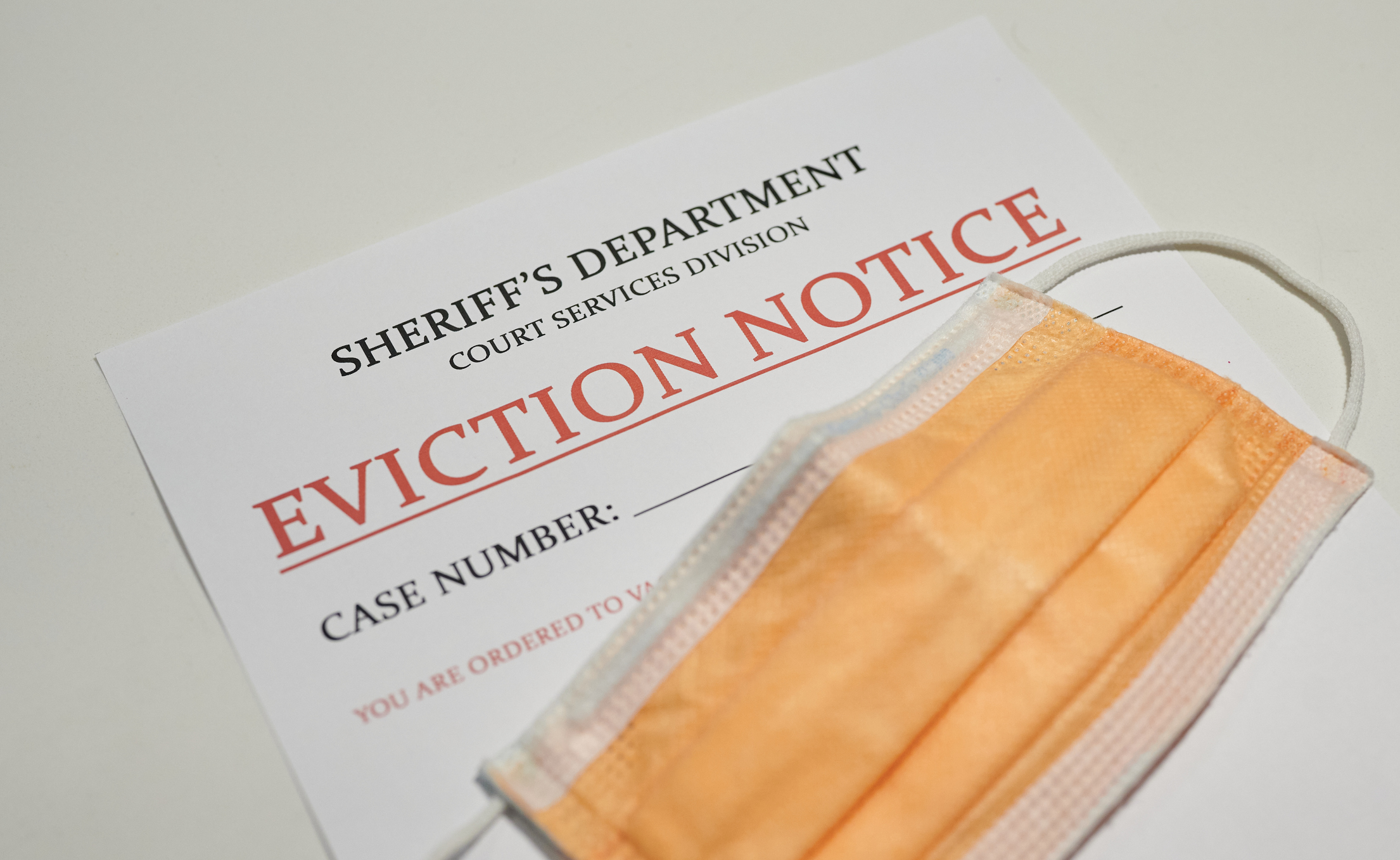 Face mask on top of an eviction notice. Image credit: iStock