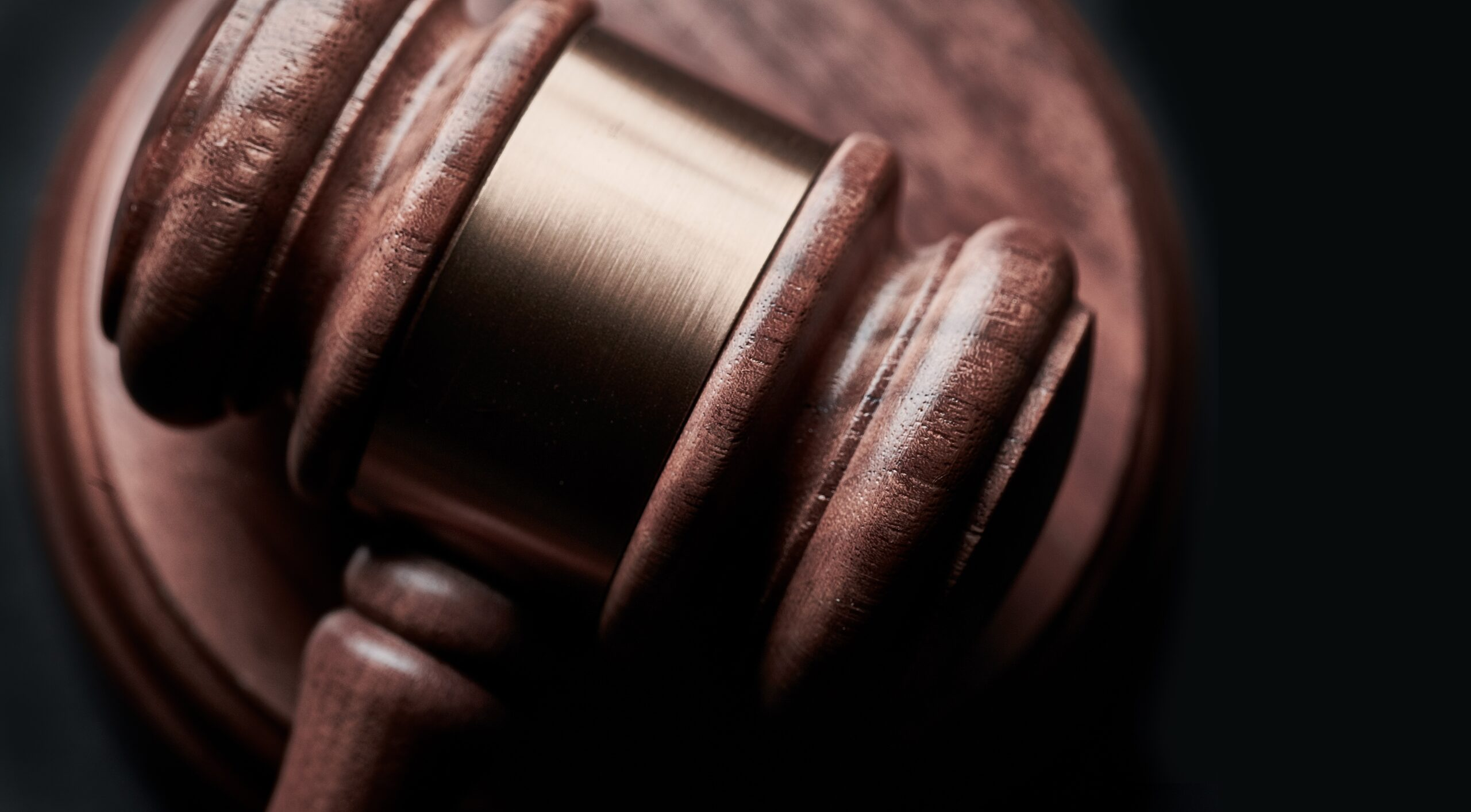 Gavel on black background with copy space. Concept for legal, lawyer, judge, law, auction and attorney. Image credit: Bill Oxford, Unsplash