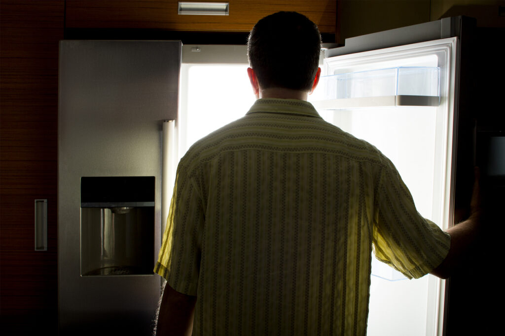 A man looks into an empty refridgerator. Image credit: iStock