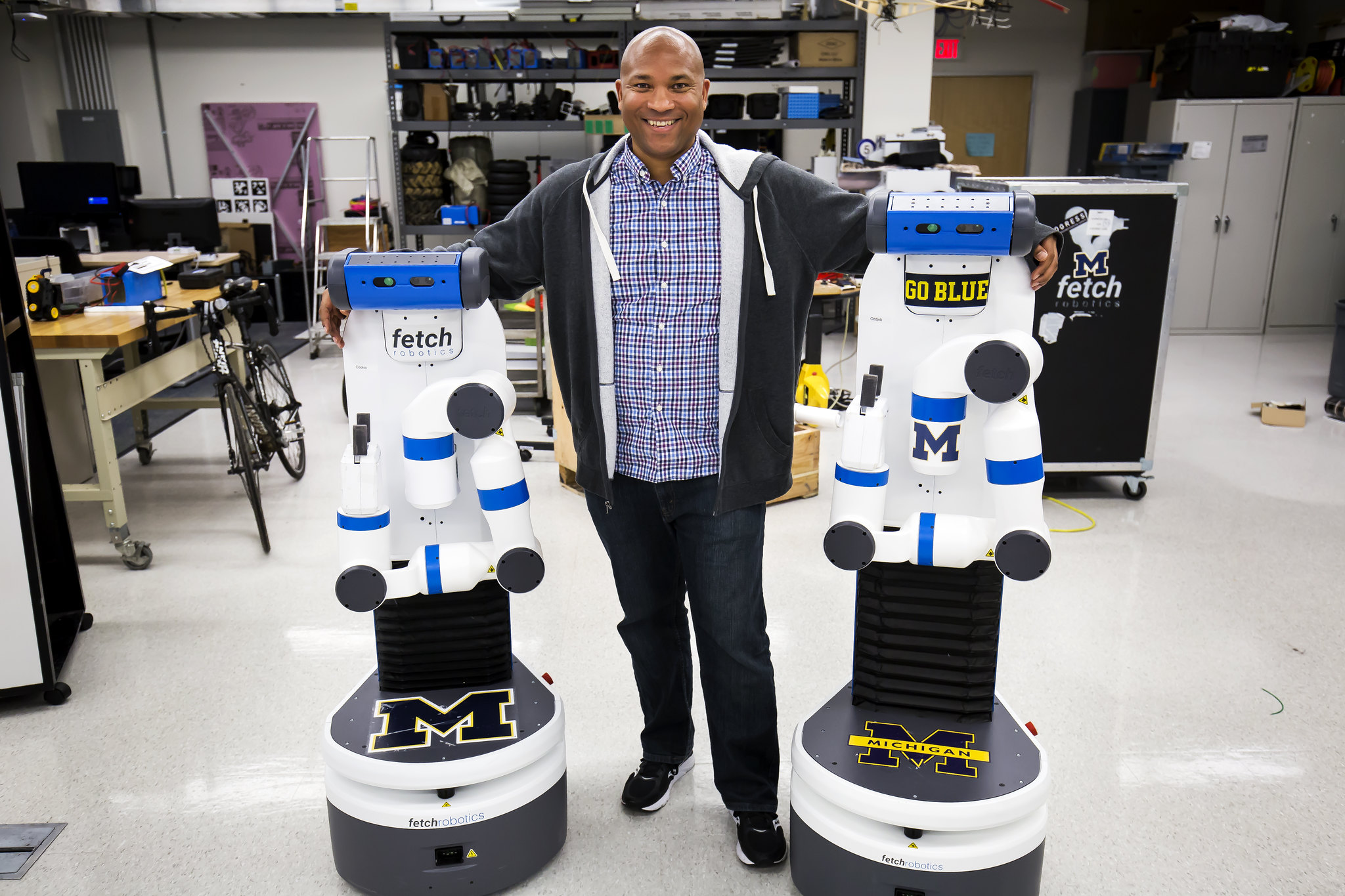 Chad Jenkins, CSE Associate Professor, poses with his research group's two robots, Odd Job and Cookie, in the Beyster Building on October 27, 2016. Image credit: Joseph Xu/Michigan Engineering Multimedia Content Producer, University of Michigan