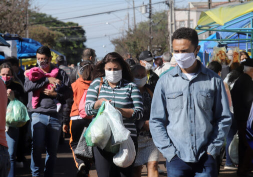 People all wearing a mask, to protect themselves from COVID-19. Image credit: iStock