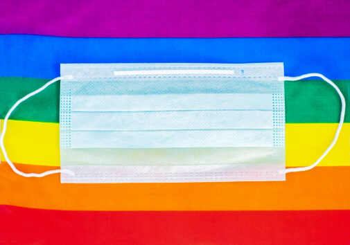 Pride flag behind a medical face mask. Image credit: iStock