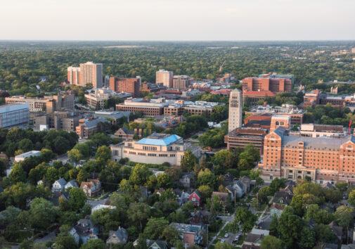 Summer Aerials: Central Campus - Burton Tower, Rackham, North Quad, Hatcher, Shapiro, UGLI, West Hall. Image credit: Michigan Photography