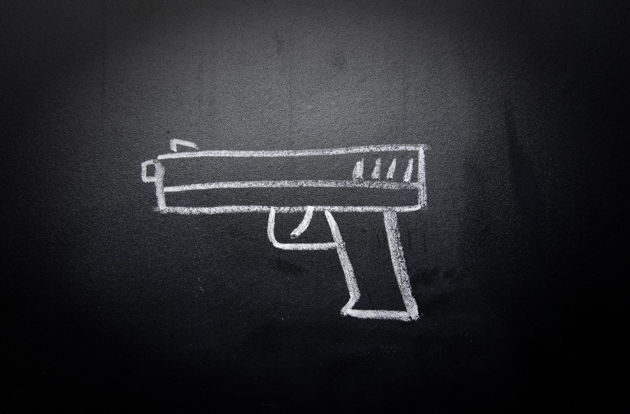 Weapon drawn on blackboard. Image credit: iStock