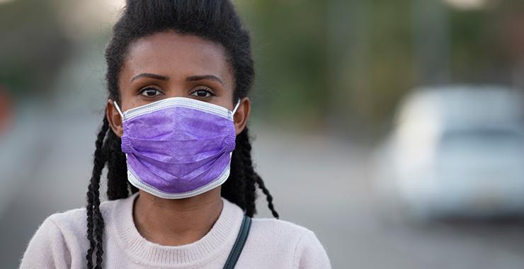 Black woman wearing mask. Image credit: APA