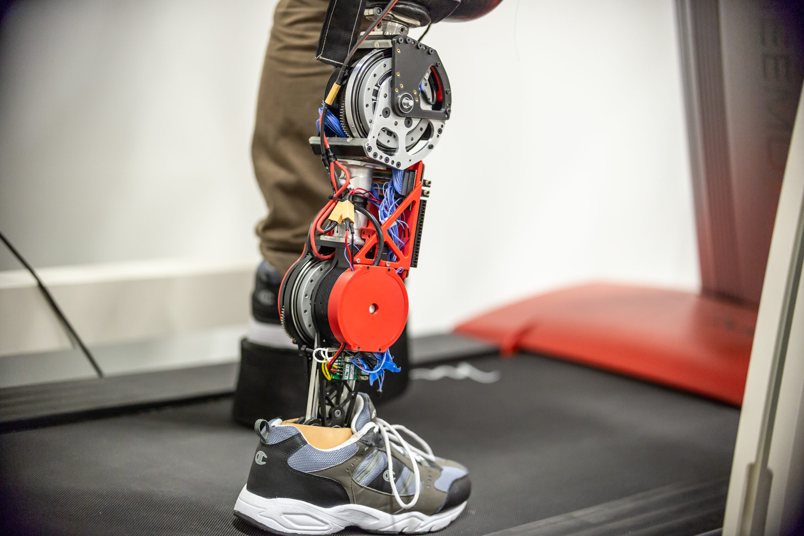 A student tests the robotic leg at the University of Texas at Dallas. The strong motors powering the knee and ankle can propel the user's body while allowing the knee to swing freely, with regenerative braking to extend battery life. Image credit: University of Texas at Dallas