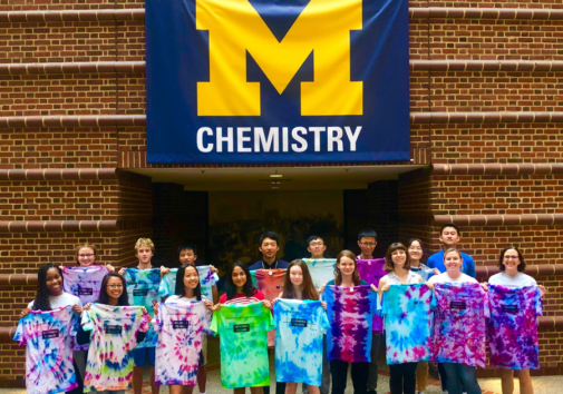 The 2019 group holds tie-dyed T-shirts they made on the last day of camp. Image credit: The McNeil Group