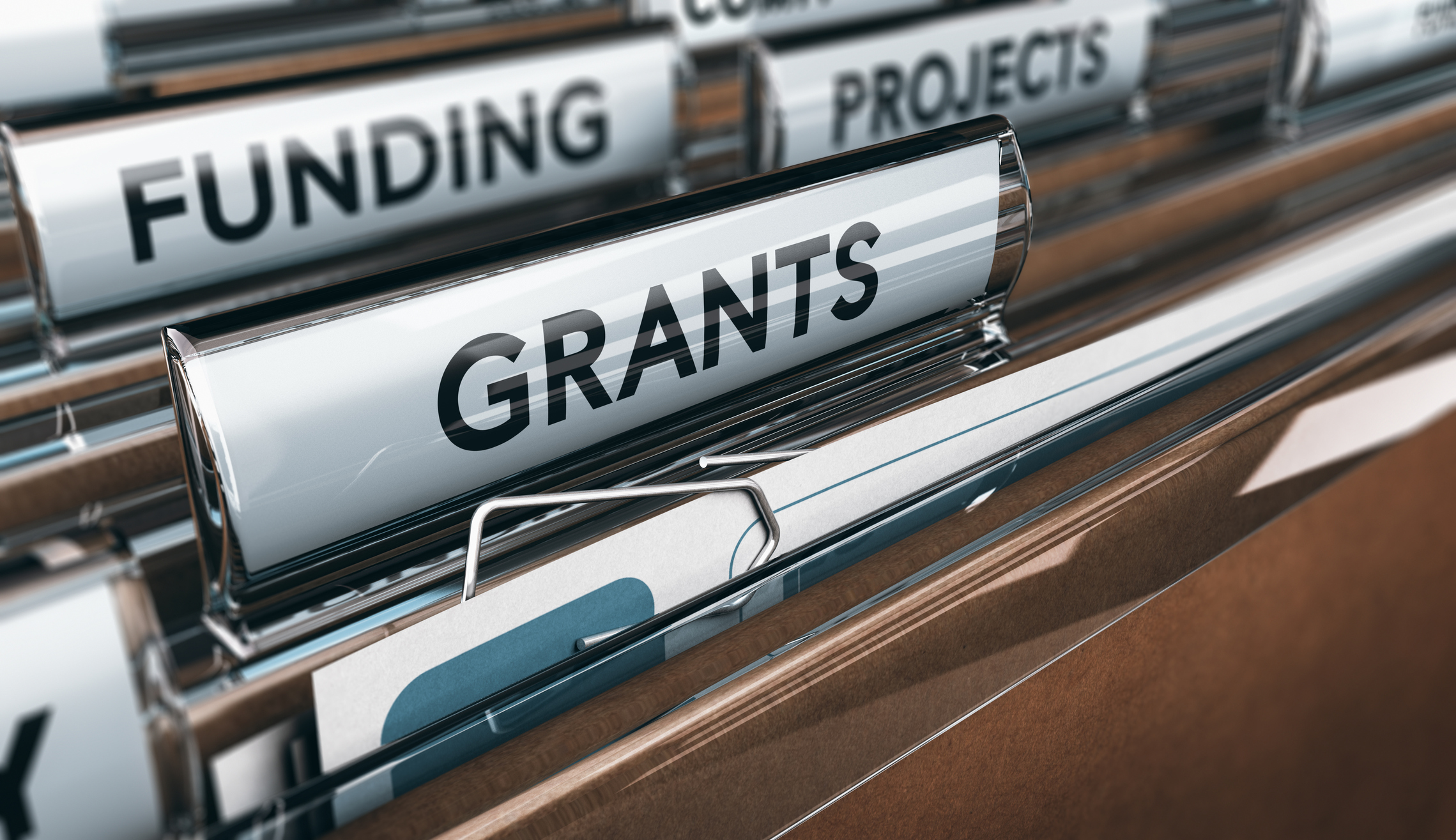 View of brown folders, with focus on grants label, Concept of funding, 3D illustration. Image credit: iStock