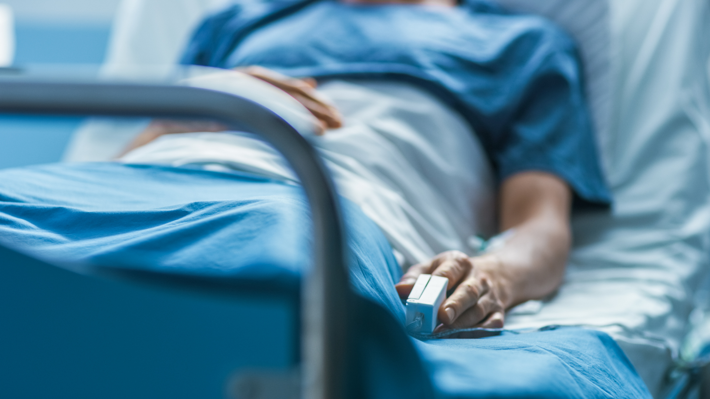 Hospital patient alone in bed. Image credit: iStock
