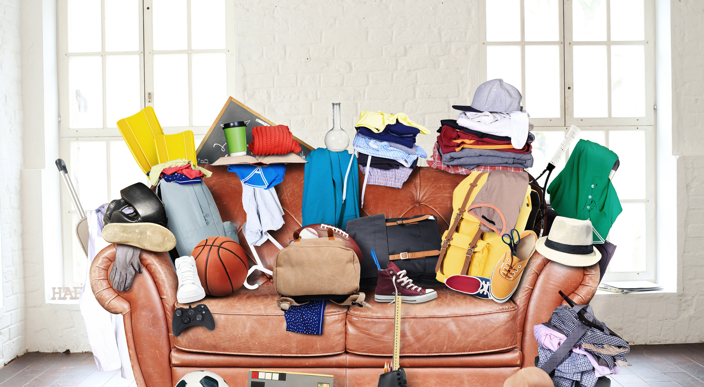 Large leather sofa with a bunch of different things Image credit: dorian2013, iStock