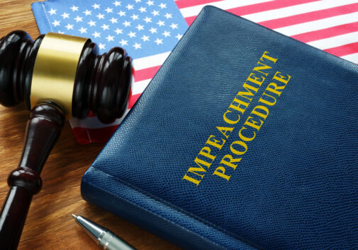 Impeachment procedure law, gavel and USA flag. Image credit: iStock