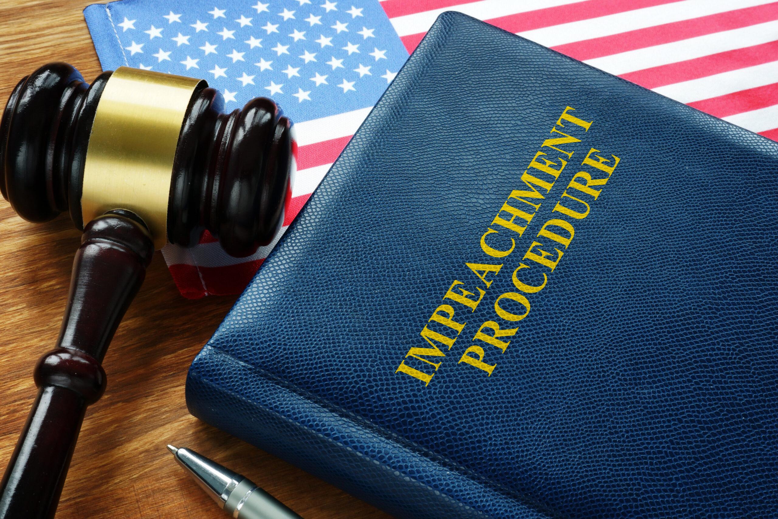 Impeachment procedure law, gavel and USA flag. Image credit: iStock
