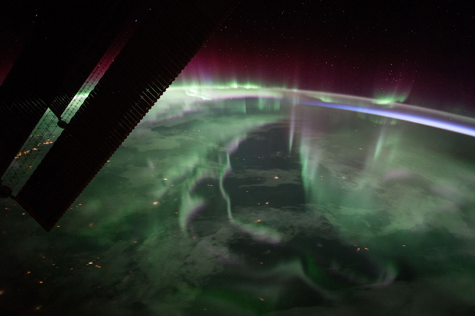 "The spectacular aurora borealis, or the ""northern lights,"" over Canada is sighted from the International Space Station near the highest point of its orbital path. The station's main solar arrays are seen in the left foreground. Photo: NASA"