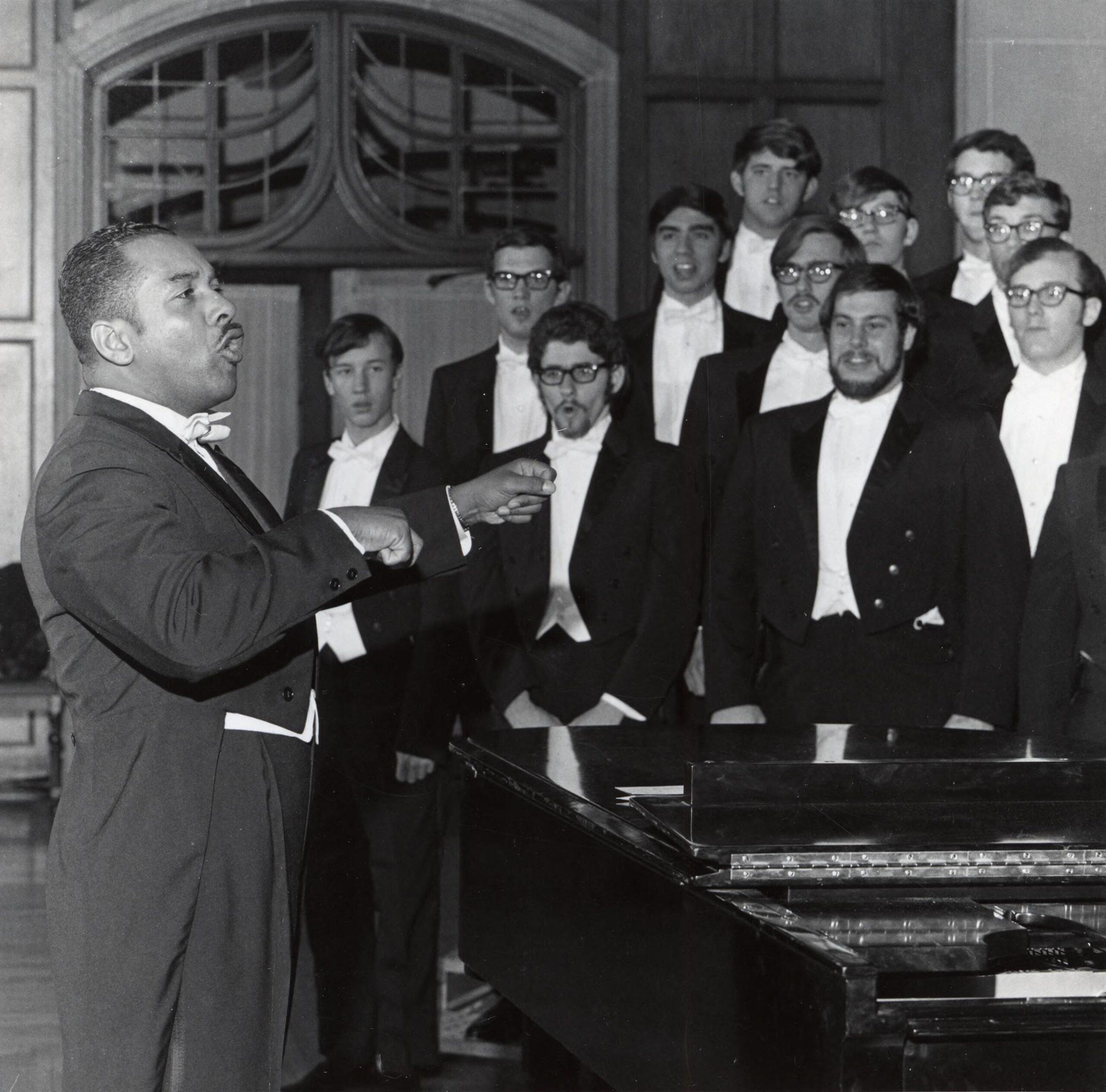 Willis Patterson, professor emeritus, University of Michigan School of Music, Theatre & Dance, conducts the Michigan Men's Glee Club, 1970. Image credit: the U-M Bentley Historical Library.