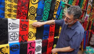 "Ron Eglash, a professor at the University of Michigan School of Information and Penny W. Stamps School of Art and Design, discusses fractal patterns on African textiles during the filming of ""Enslaved."" Image credit: Ron Eglash."