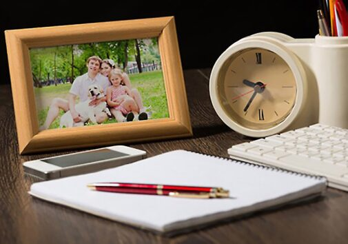 Stock image of framed family photo on a desk