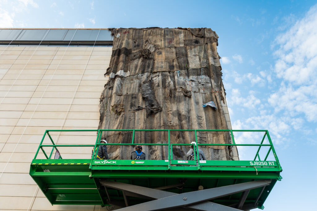 Installed last week, the resulting massive, quilt-like panels were used to cover 4,452 square feet of the exterior of the U-M Museum of Art to create one of the spectacular architectural interventions Mahama is known for. Image credit: Eric Bronson, Michigan Photography