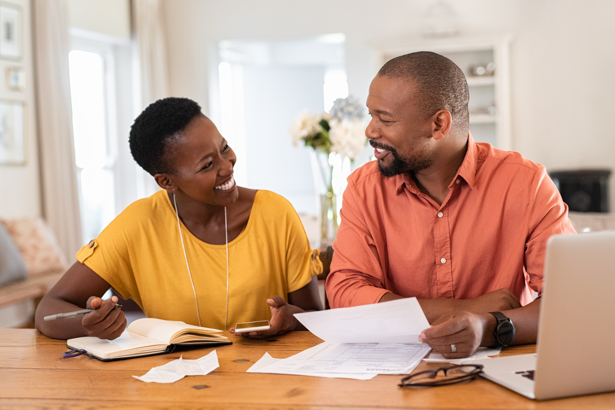 Husband and wife looking at finances. Image credit: iStock