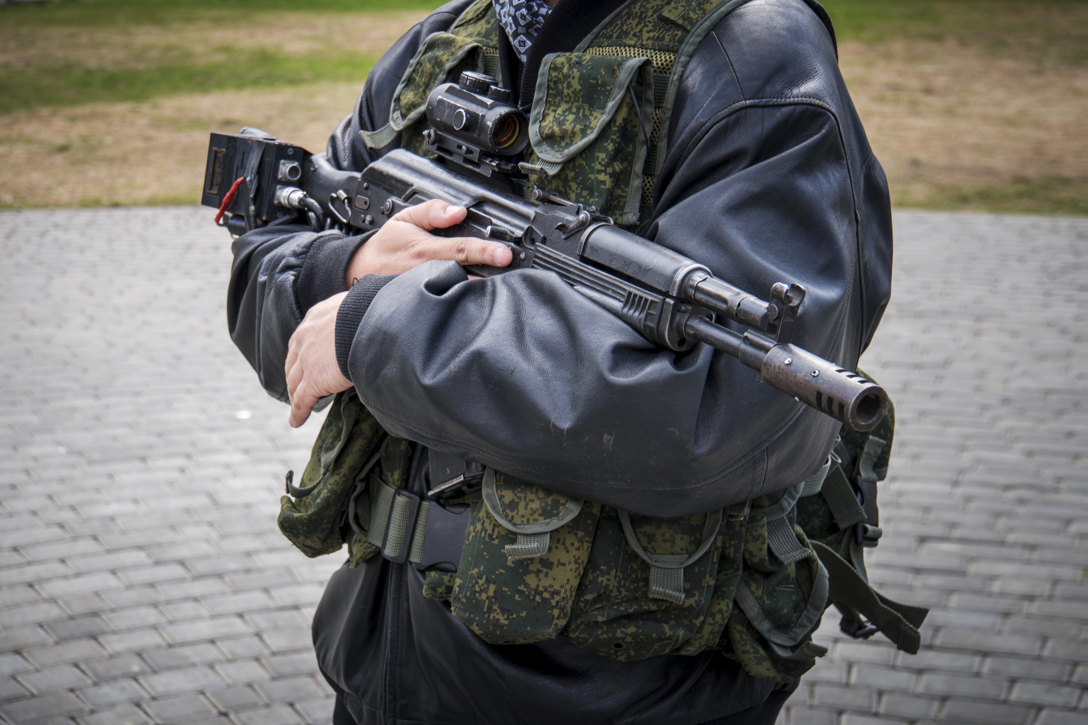 a man with a machine gun. male men's hands holding a rifle. Irregular troops. unprofessional military. Militiaman. Kalashnikov assault rifle with laser sniper scope. separatists. Image credit: Diy13