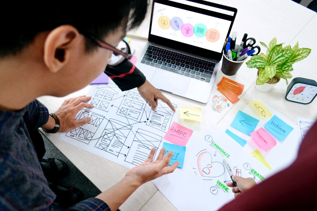 A group working on a design project. Image credit: UnSplash.com