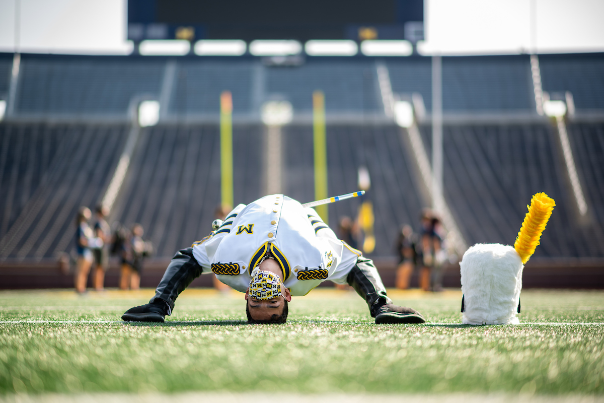 It took Drum Major Walter Aguilar about a year to perfect the iconic Michigan backbend. Image credit: Eric Bronson/Michigan Photography