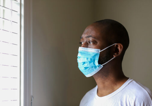 An African-American man wearing a protective face mask to prevent virus infection. Image credit: iStock