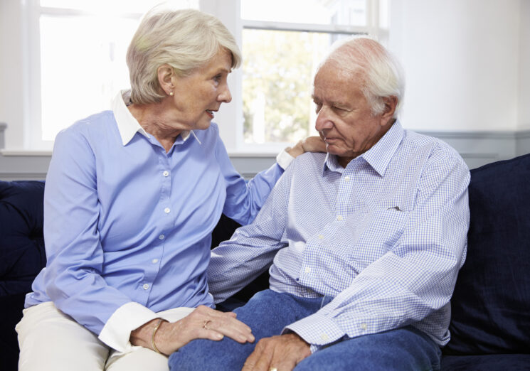 Wife Talking To Depressed Senior Husband At Home. Image credit: iStock