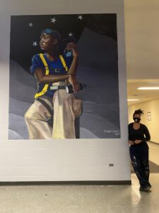 """Sarah the Whatevershechoosestobe-(h)er"" by Sydney James (pictured) is a new mural on view in the lobby of the University of Michigan's Modern Languages Building. It was completed in October 2020. Image credit: Amanda Krugliak"
