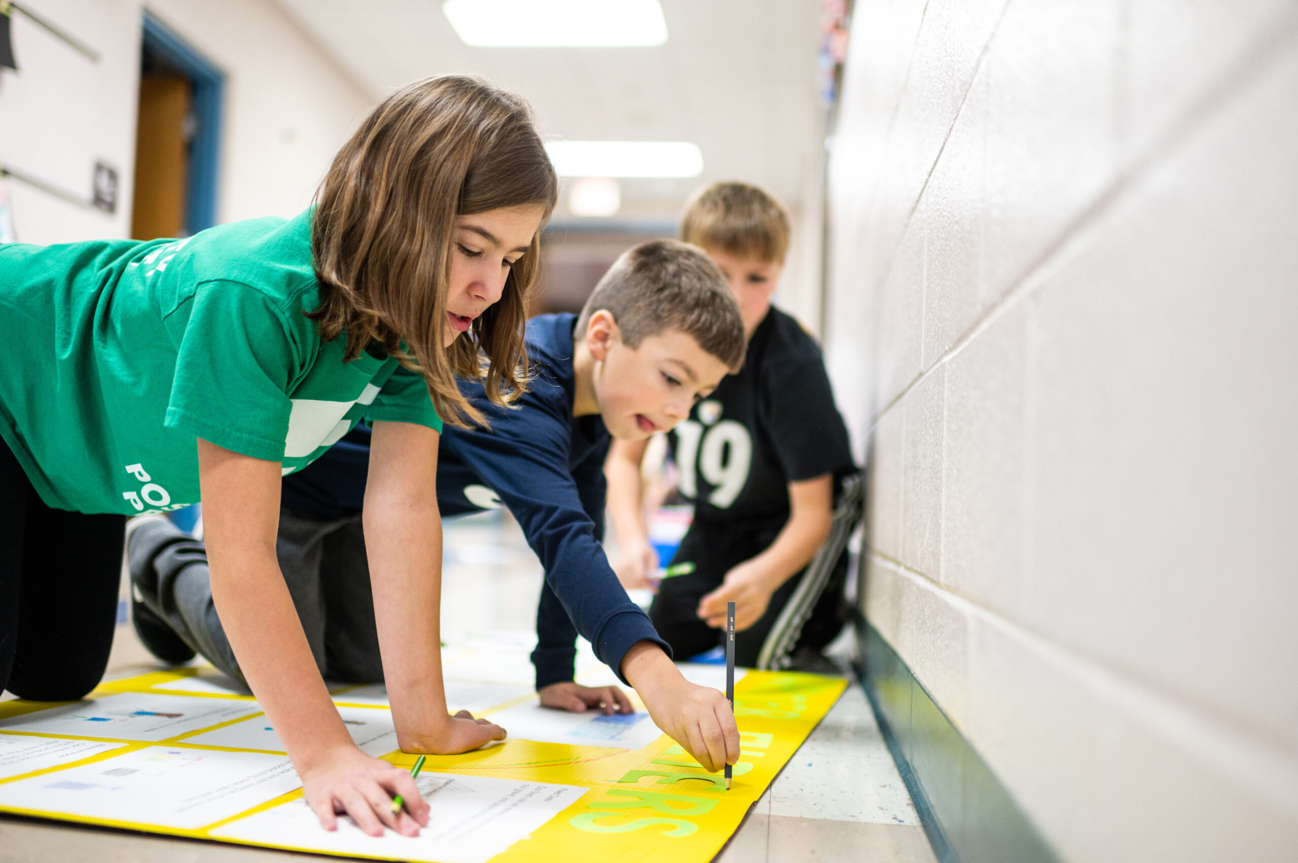 Students from Mason Elementary School of Grand Blanc Community Schools work on their Young Shark presentation. Image credit: Eric Bronson / Michigan Photography