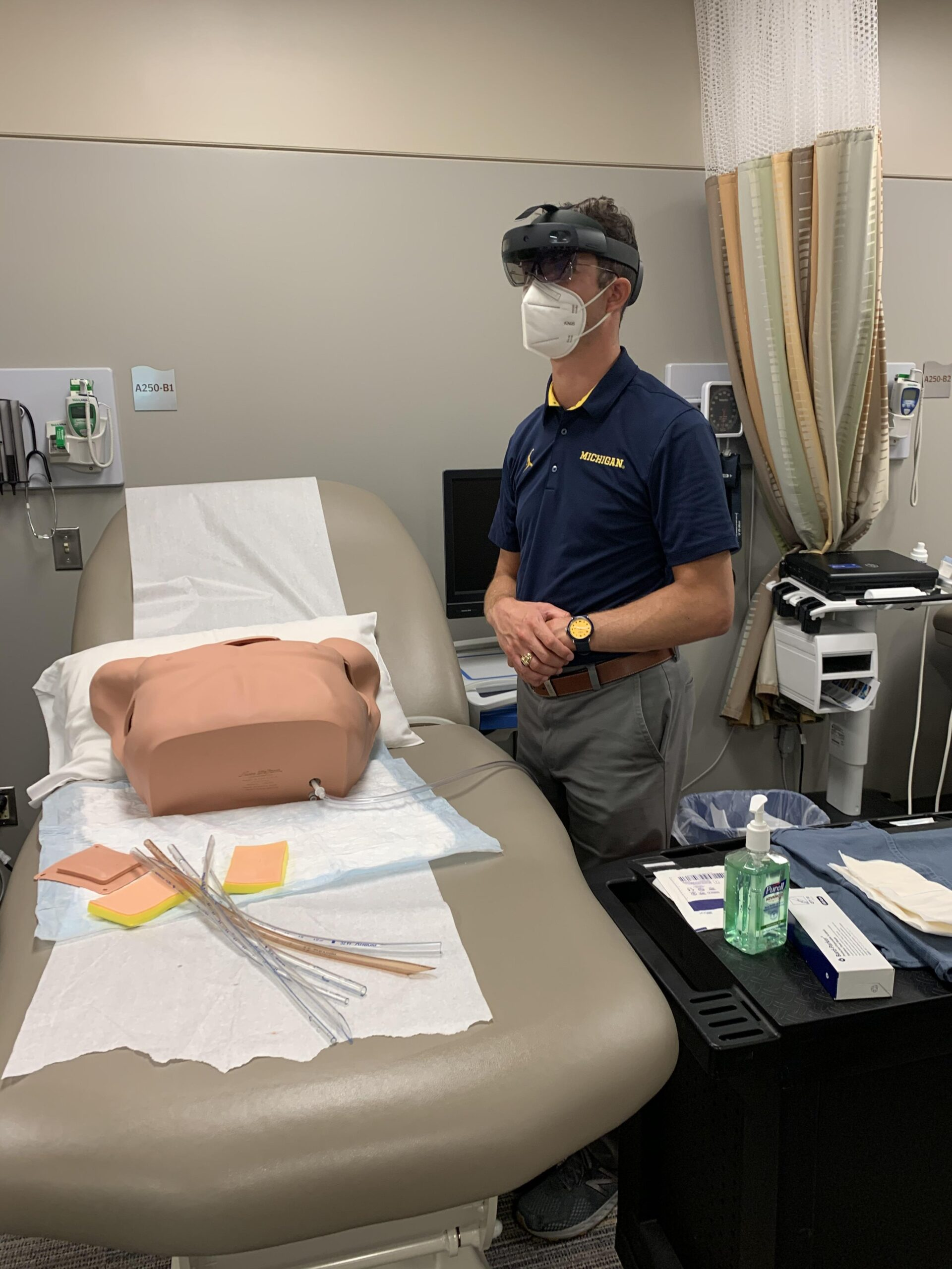 Brian Kaminski practicing a catheterization procedure using the HoloLens2. Image credit: U-M School of Nursing