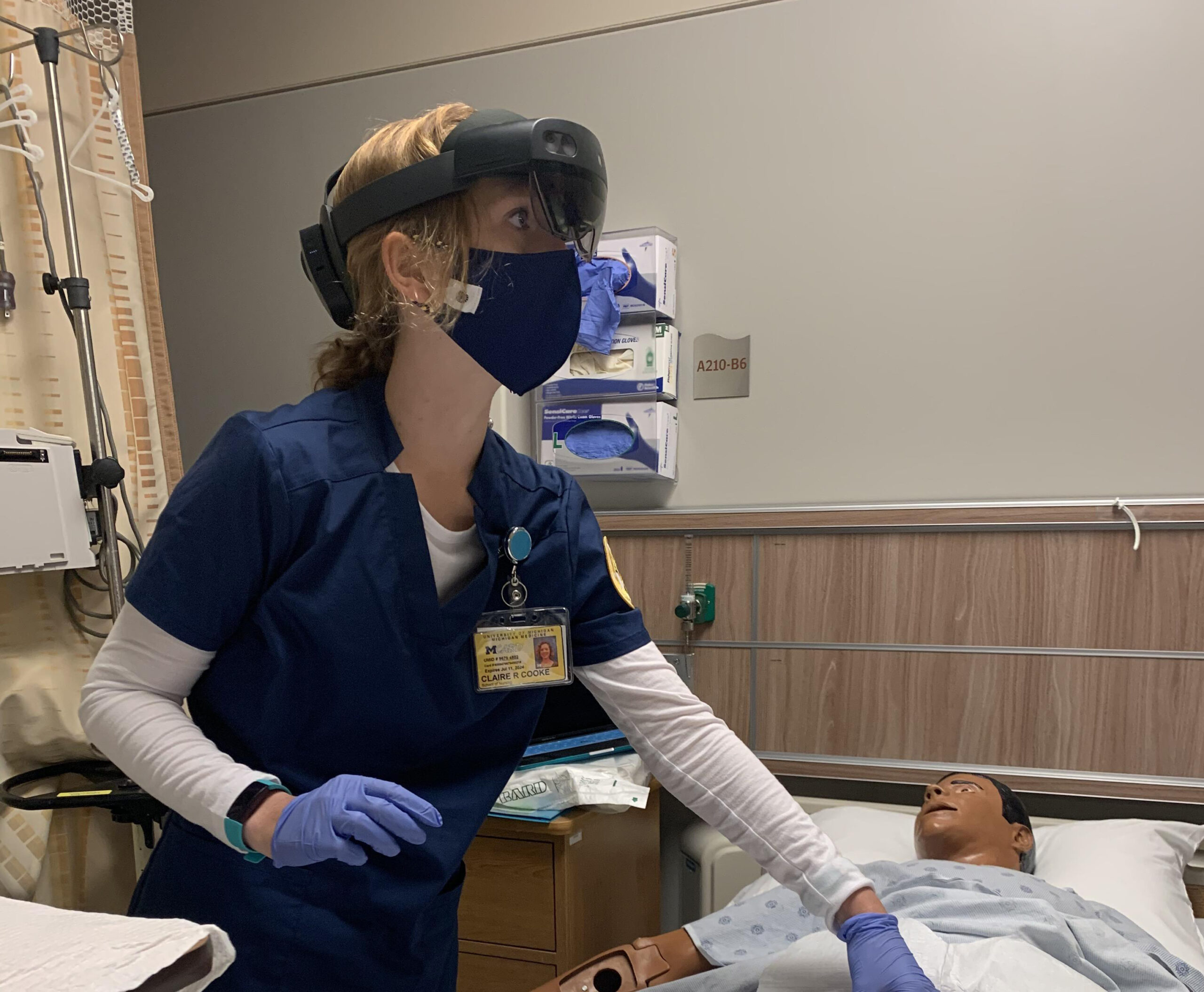 Student Claire Cook performing a procedure using the HoloLens2. Image credit: U-M School of Nursing