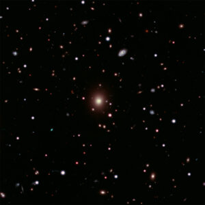 This image of Abell 2261 contains X-ray data from Chandra (pink) showing hot gas pervading the cluster as well as optical data from Hubble and the Subaru Telescope that show galaxies in the cluster and in the background. Astronomers used these telescopes to search galaxy in the center of the image for evidence of a black hole, weighing between 3 and 100 billion times the Sun, that is expected to be there. No sign of this black hole was found, deepening a mystery about what is happening in this system. Image credit: X-ray: NASA/CXC/Univ of Michigan/K. Gültekin ; Optical: NASA/STScI and NAOJ/Subaru; Infrared: NSF/NOAO/KPNO; Radio: NSF/NOAO/VLA