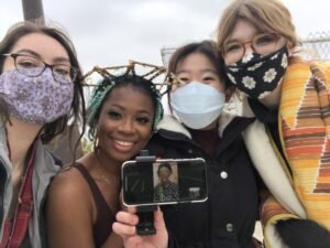 Left to right: University of Michigan students Kenzie Hill, Amber Cierra Merritt, Shannon Yeung, and Grace Klein pose with Ayana Evans during the shoot. Evans directed the entire day via Facetime from her home in New York. Image credit: Shannon Yeung.