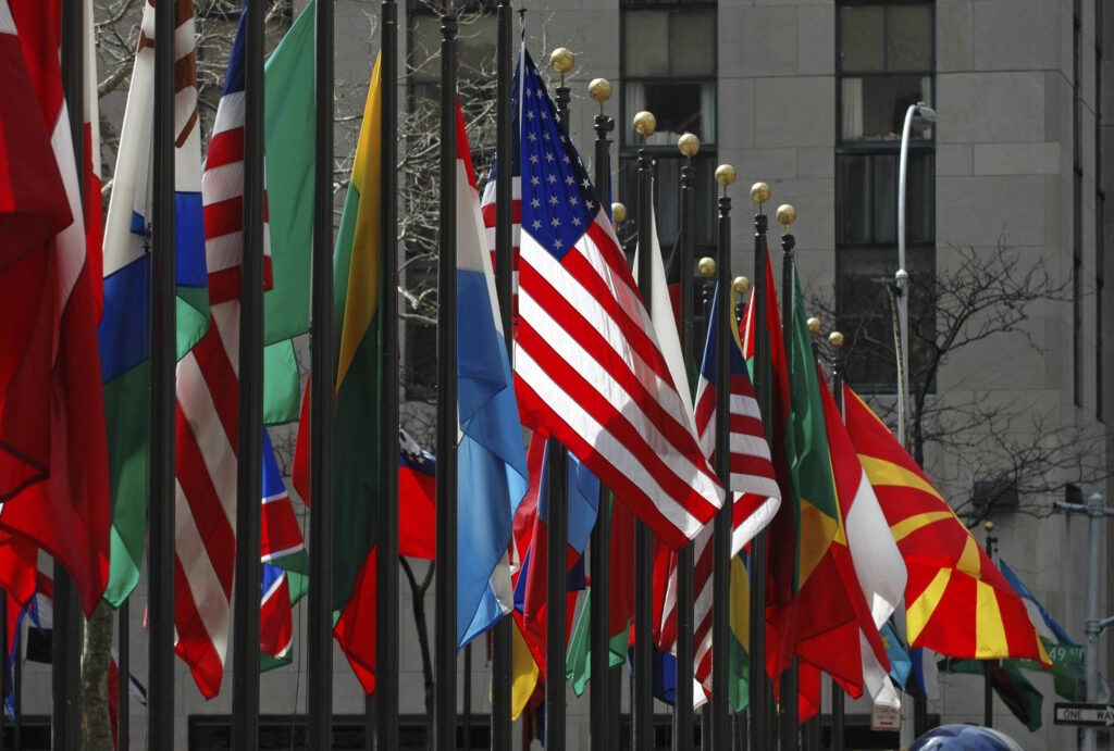 The American flag stands out among others from around the world on display at Rockefeller Center in Manhattan. Image credit: iStock