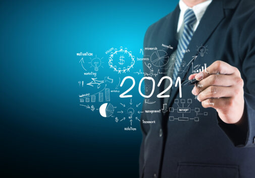 Business man drawing new year 2021 charts graphs business success strategy plan ideas concept. Image credit: iStock