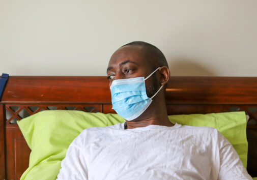 An African-American man wearing a protective face mask to prevent virus infection. Image credit: Robin Gentry, iStock