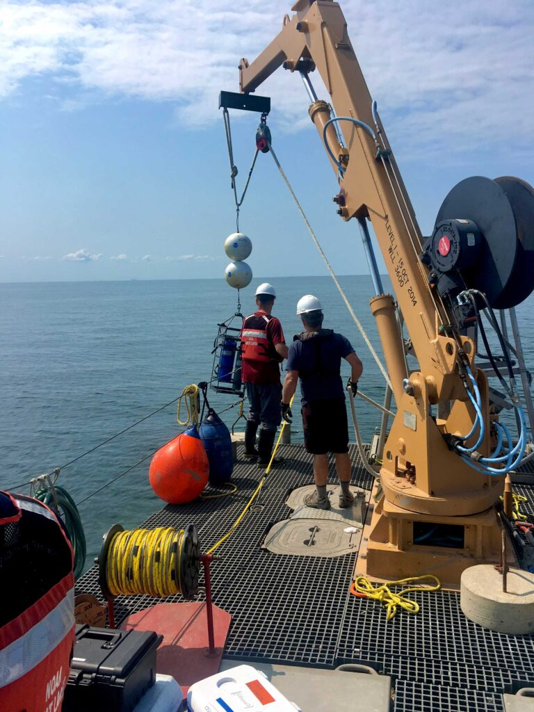 Researchers lower a robotic laboratory from the stern of a ship to the bottom of Lake Erie's central basin in July 2019 for a University of Michigan-led study of phosphorus released from muddy lake-bottom sediments. Two of the autonomous labs were deployed: one at a depth of 67 feet and the other at a depth of 79 feet. Image credit: Hanna Anderson