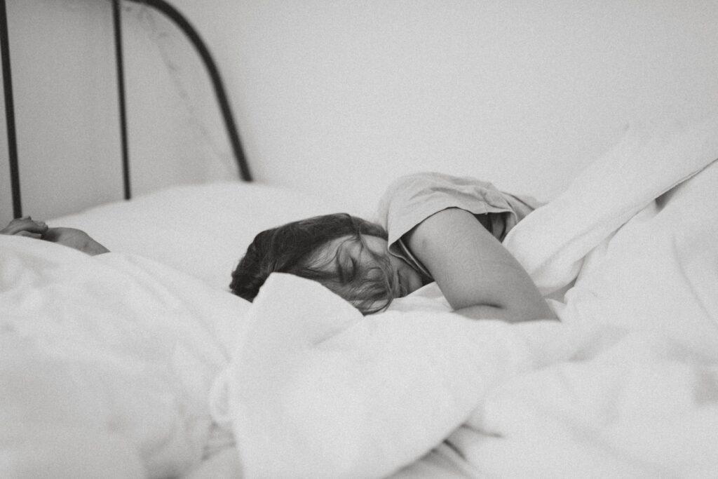 A woman sleeping. Image credit: Kinga Cichewicz, Unsplash