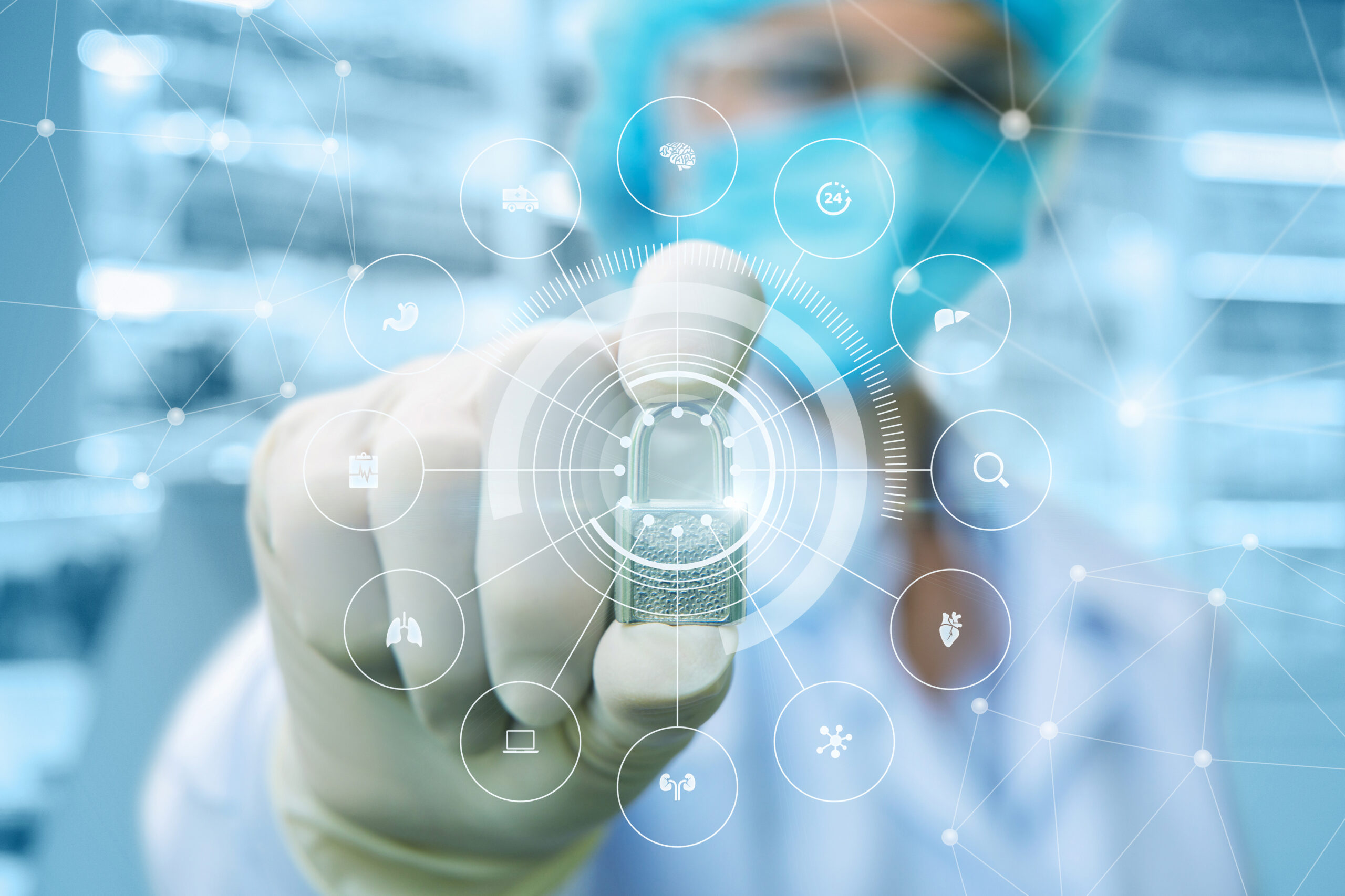 Doctor shows the system of protection of the internal organs on blurred background. Image credit: iStock