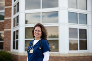 For patients leaving the hospital that still need care, Karen Neeb, a nurse practitioner at Michigan Medicine, provides them with home monitoring kits. Image credit: Eric Bronson, Michigan Photography