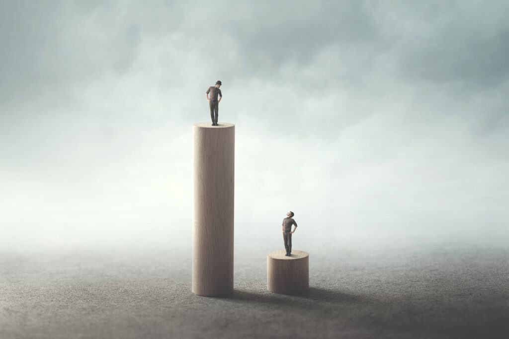 Abstract equality concept between two men. Image credit: iStock