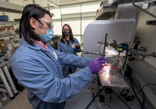Two scientists, Francesca Toma (right) and Guosong Zeng, in a lab working on artificial photosynthesis.