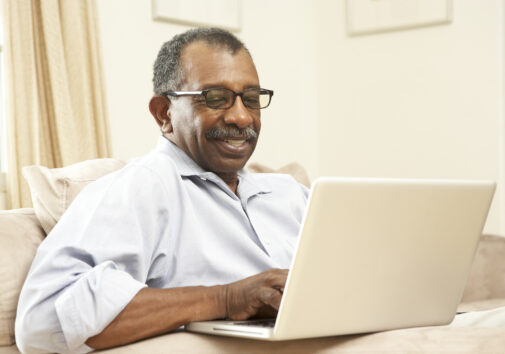 Senior man using laptop at home. Image credit: monkeybusinessimages, iStock