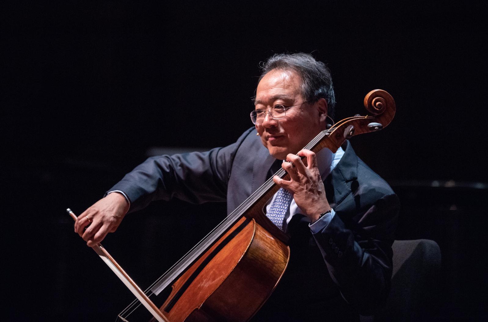 Yo-Yo Ma on staging playing cello.