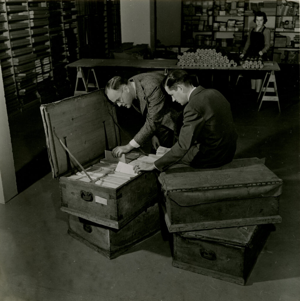 Curators and staff Lloyd Brown, Howard Peckham, and Margaret Webber with four trunks of Thomas Gage papers as they arrived at the William L. Clements Library in 1937. Image courtesy: William L. Clements Library