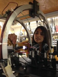 U-M graduate student Midhat Farooq in the Chupp lab works on development of the 3He magnetometer used to confirm calibration of measurements of the storage ring magnetic field. Image credit: Chupp Lab