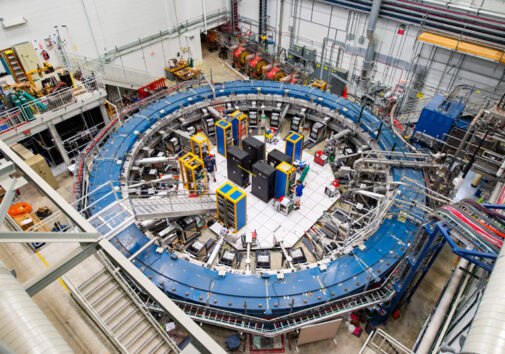The Muon g-2 ring sits in its detector hall amidst electronic racks, the muon beamline and other equipment. The experiment operates at negative 450 degrees Fahrenheit. Image credit: Reidar Hahn