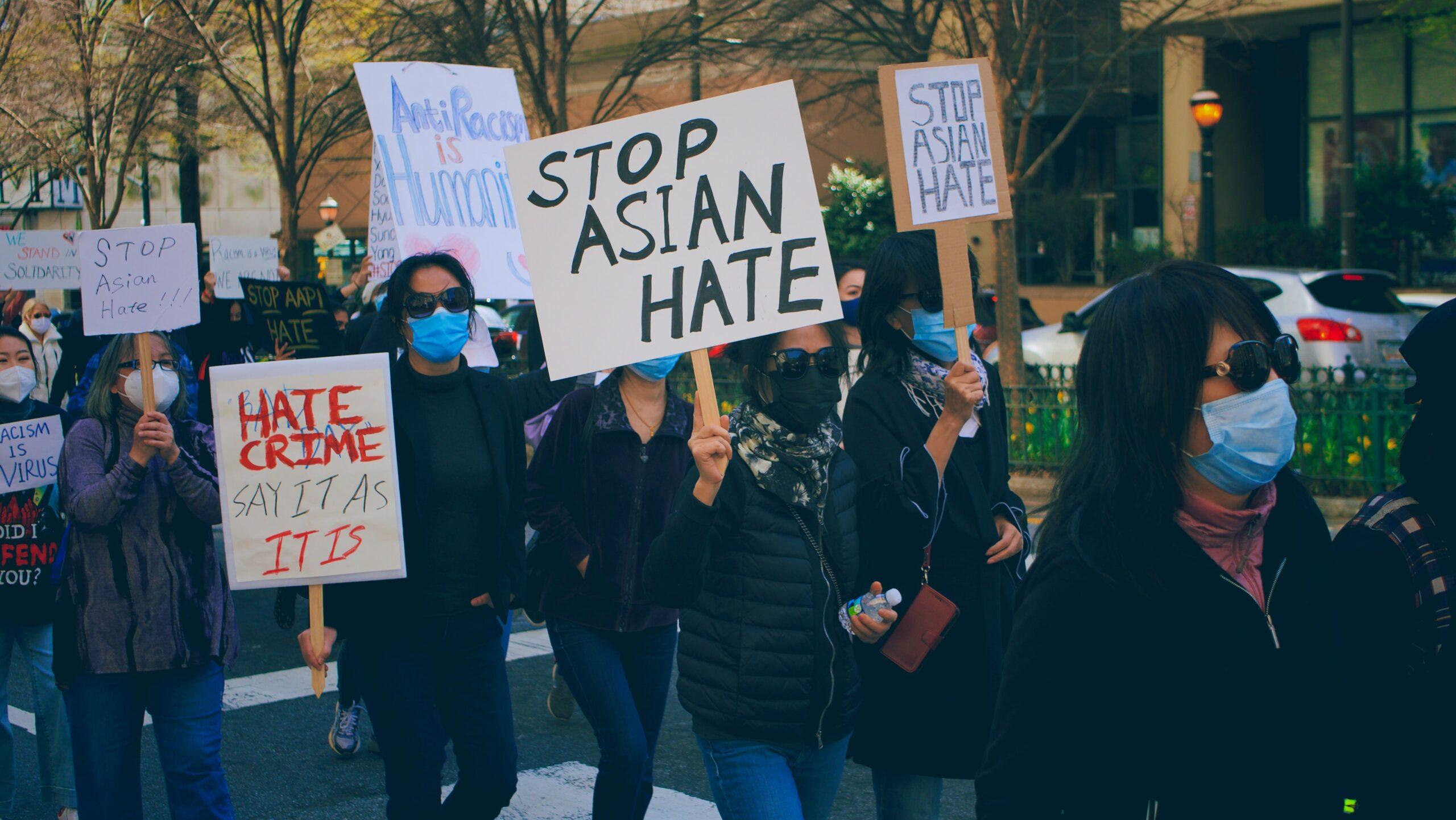 Anti-Asian Hat protest. Image Credit: Kareem Hayes on Unsplash